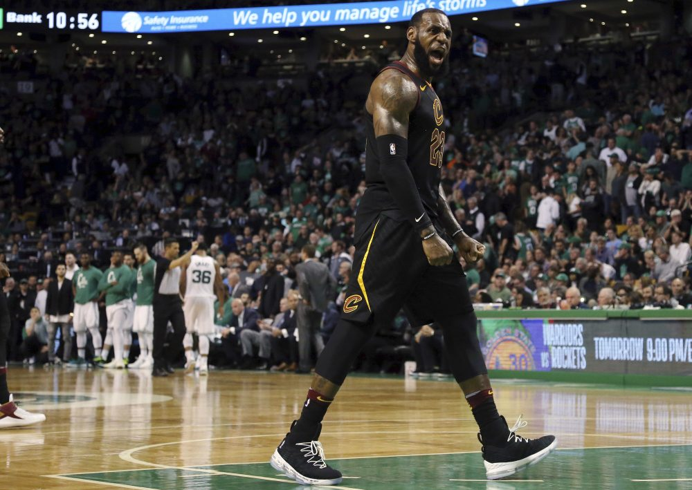 Cleveland Cavaliers forward LeBron James celebrates as his team pulls away from the Boston Celtics near the end of the second half in Game 7 of the NBA basketball Eastern Conference finals, Sunday, May 27, 2018, in Boston. (Elise Amendola/AP)
