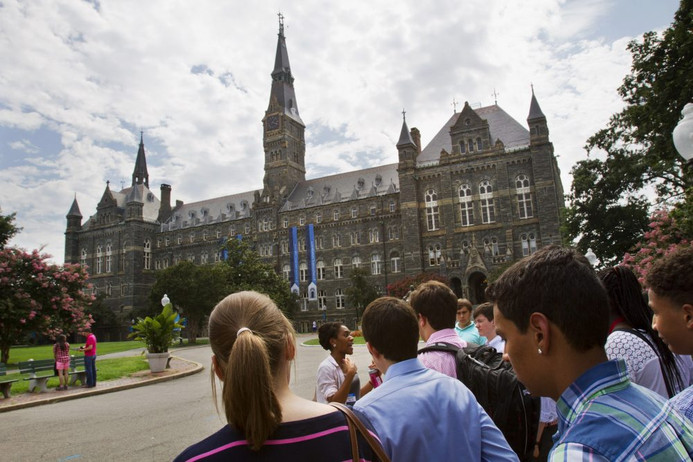 In this July 10, 2013, file photo, prospective students tour Georgetown University's campus in Washington. (Jacquelyn Martin/AP)