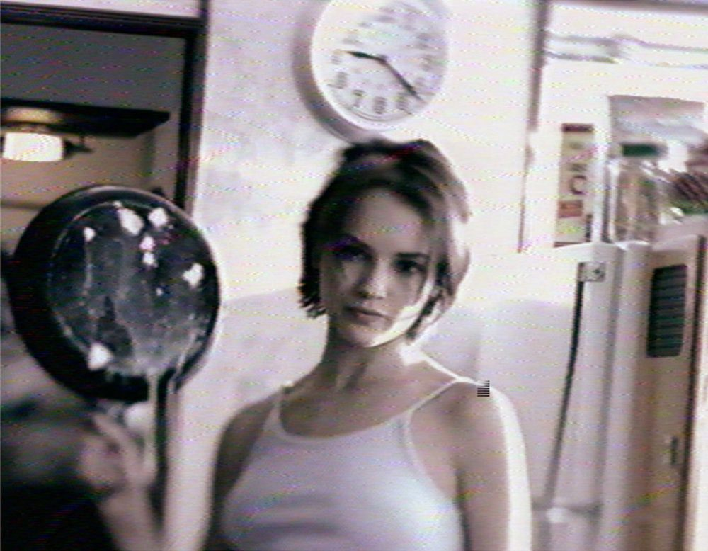 """A still image from a 1998 ad in which a young woman first holds up an egg, then a frying pan: """"This is your brain. This is heroin."""" She then smashes the egg with the fying pan, and the shattered egg drips onto the kitchen counter. """"This is what happens to your brain after snorting heroin. This is what your body goes through."""" (AP Photo)"""