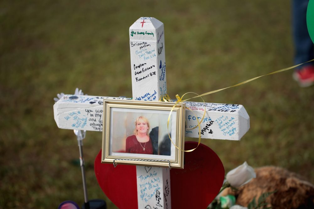 A photo of Cynthia Tisdale hangs on a cross at a memorial in front of Santa Fe High School on May 22, 2018 in Santa Fe, Texas. (Scott Olson/Getty Images)