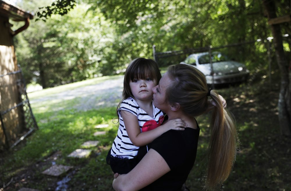 Whitney Duncan holds her daughter, Deklyn, 3, while visiting her at the home she's staying at with her grandmother in Jasper, Ga., Monday, June 26, 2017. Duncan and her husband were given a choice after failing a drug screening in 2016; lose their daughter to foster care or temporarily give her to a family member while they enter the county's two-year family drug court program to help with their opioid addiction. (David Goldman/AP)