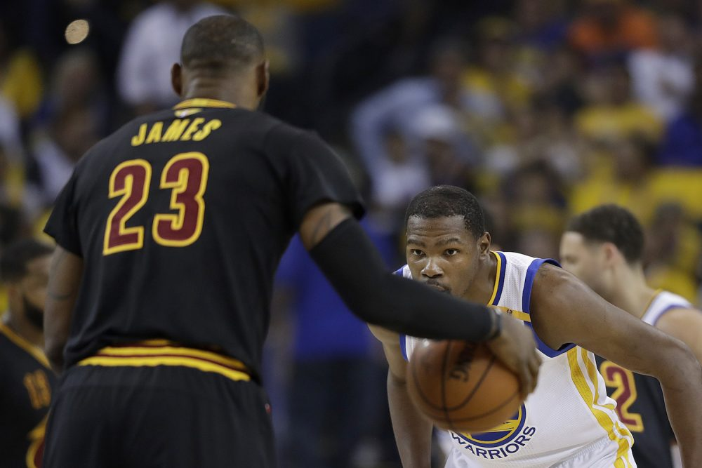 Golden State Warriors forward Kevin Durant, right, defends Cleveland Cavaliers forward LeBron James (23) during the first half of Game 5 of basketball's NBA Finals in Oakland, Calif., Monday, June 12, 2017. (Marcio Jose Sanchez/AP)