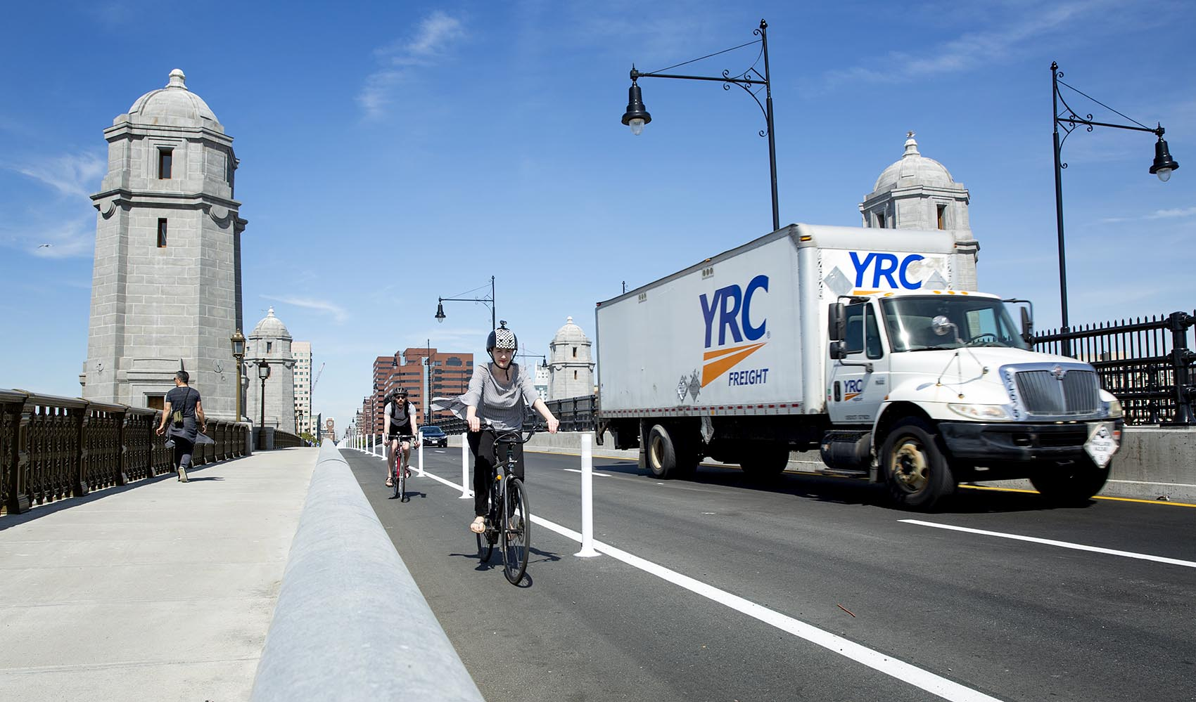 Drivers, bicyclists and pedestrians cross the Longfellow Bridge after it reopened fully Thursday morning. (Robin Lubbock/WBUR)