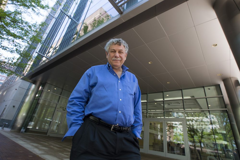 Geneticist Eric Lander stands outside of the Broad Institute in Kendall Square. (Jesse Costa/WBUR)