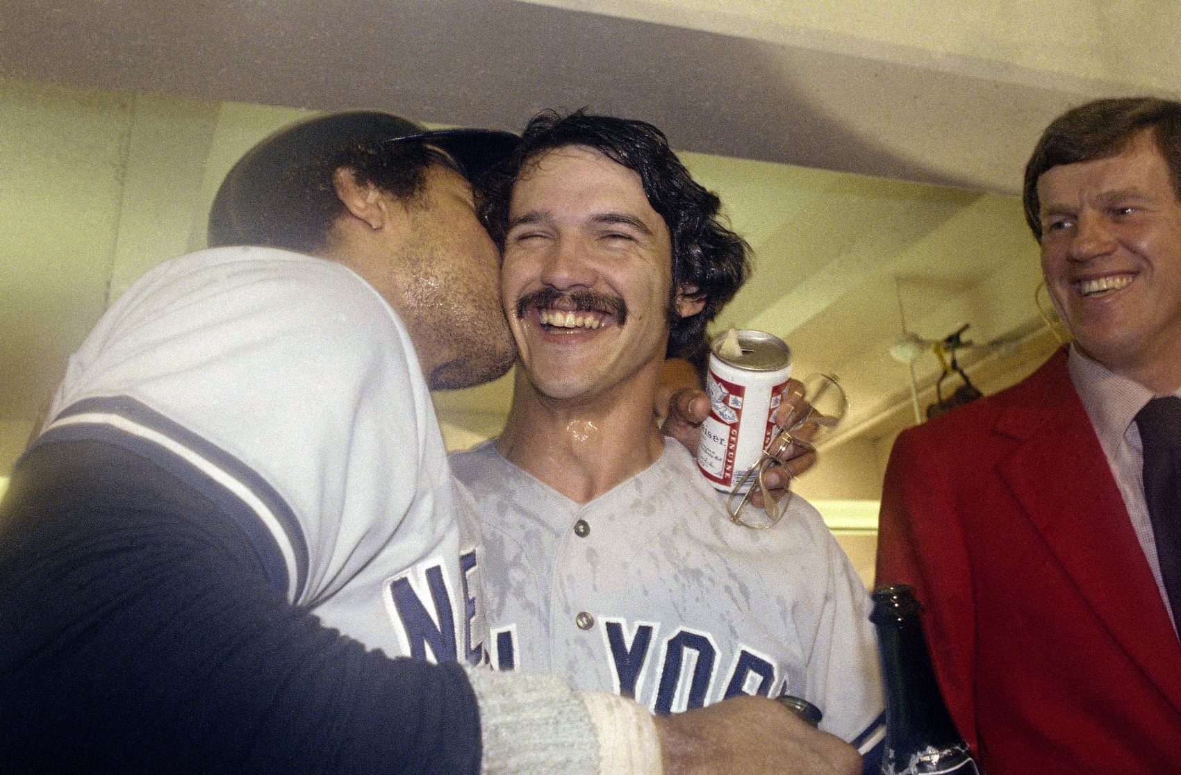 Reggie Jackson kisses Ron Guidry after New York Yankees win the 1978 World Series. (AP)