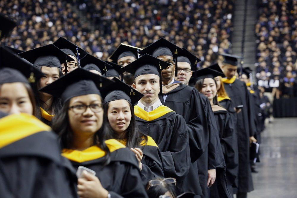 Graduates of Baruch College participate in a commencement program at Barclays Center, Monday, June 5, 2017, in the Brooklyn borough of New York. (Bebeto Matthews/AP)