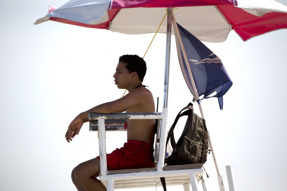 A lifeguard keeps watch at Revere Beach in Revere, Mass., Friday, July 21, 2017, in Revere, Mass. (AP Photo/Michael Dwyer)