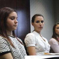 In this photo, Kaylee Lorincz, from left, Rachael Denhollander and Lindsey Lemke, all victims of Dr. Larry Nassar speak after a plea hearing in Lansing, Mich., Wednesday, Nov. 22, 2017. Michigan State University has reached a $500 million settlement with hundreds of women and girls who say they were sexually assaulted by Nassar in the worst sex-abuse case in sports history. The deal was announced Wednesday, May 16, 2018, by Michigan State and lawyers for 332 victims. (Paul Sancya/AP)