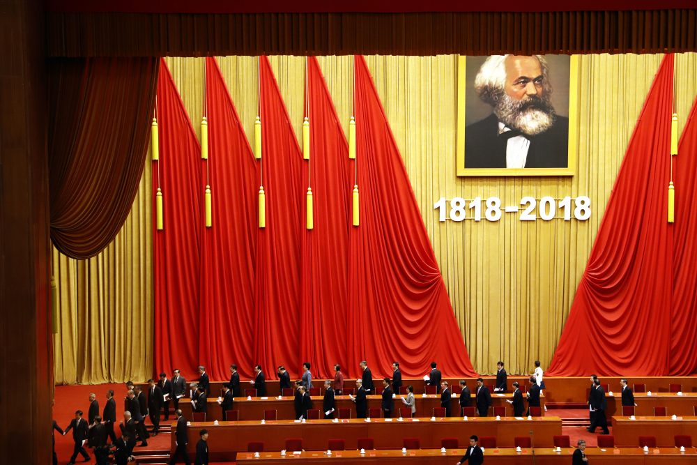 In this May 4, 2018, photo, participants leave after an event to mark the bicentennial of Karl Marx's birth at the Great Hall of the People in Beijing. Abroad, China's President Xi Jinping portrays himself as a robust defender of free markets, yet at home, he's leading a campaign to promote the works of communist philosopher Karl Marx. (Ng Han Guan/AP)