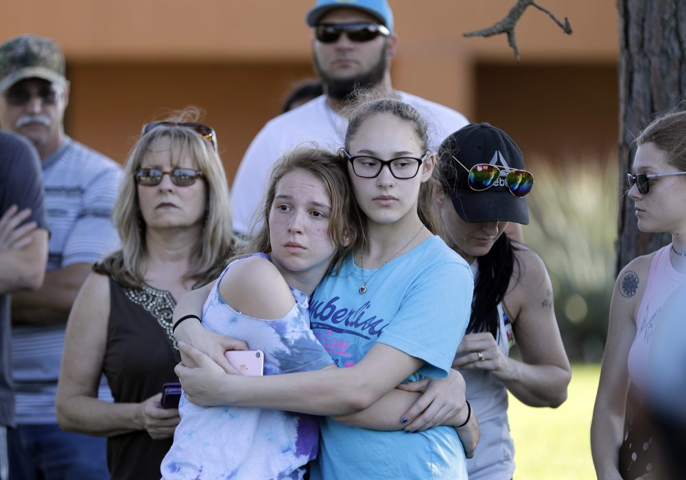 Mourners wait for the start of a prayer vigil following a deadly shooting at Santa Fe High School in Santa Fe, Texas, on Friday, May 18, 2018.  (David J. Phillip/AP)