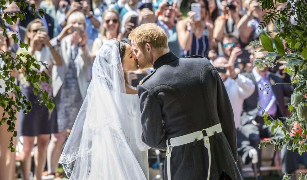 Meghan Markle and Prince Harry kiss on the steps of St George's Chapel at Windsor Castle following their wedding in Windsor Castle in Windsor, near London, England, Saturday, May 19, 2018. (Danny Lawson/AP)