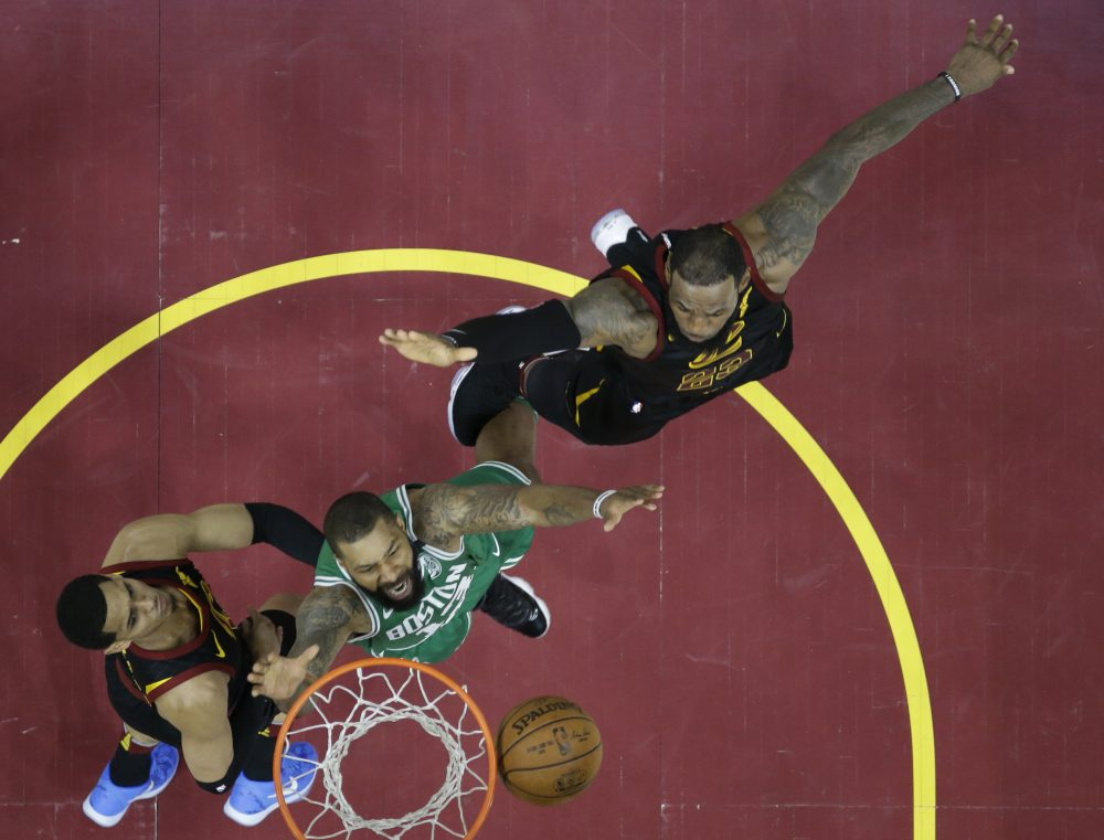 Boston Celtics' Marcus Morris (13) goes for a rebound with Cleveland Cavaliers' Jordan Clarkson (8), left, and LeBron James in the first half of Game 3 of the NBA basketball Eastern Conference finals, Saturday, May 19, 2018, in Cleveland. (Tony Dejak/AP)