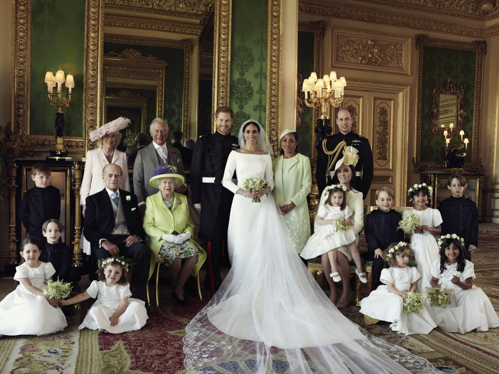 In this photo released by Kensington Palace on Monday May 21, 2018, shows an official wedding photo of Britain's Prince Harry and Meghan Markle, center, in Windsor Castle, Windsor, England, Saturday May 19, 2018. Others in photo from left, back row, Jasper Dyer, Camilla, Duchess of Cornwall, Prince Charles, Doria Ragland, Prince William; center row, Brian Mulroney, Prince Philip, Queen Elizabeth II, Kate, Duchess of Cambridge, Princess Charlotte, Prince George, Rylan Litt, John Mulroney; front row, Ivy Mulroney, Florence van Cutsem, Zalie Warren, Remi Litt. (Alexi Lubomirski/AP)