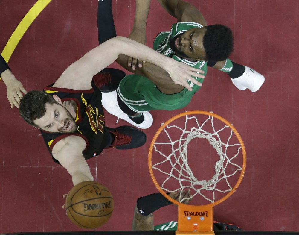 Cleveland Cavaliers' Kevin Love, left, drives to the basket against Boston Celtics' Jaylen Brown in the second half of Game 4 of the NBA basketball Eastern Conference finals, Monday, May 21, 2018, in Cleveland. The Cavaliers won 111-102. (Tony Dejak/AP)