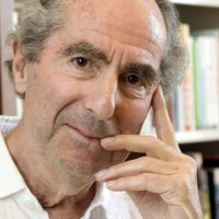 In this Sept. 8, 2008, file photo, author Philip Roth poses for a photo in the offices of his publisher, Houghton Mifflin, in New York. Roth, prize-winning novelist and fearless narrator of sex, religion and mortality, has died at age 85, his literary agent said Tuesday, May 22, 2018. (Richard Drew/AP)