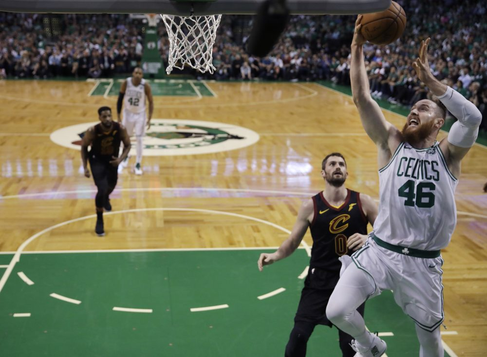 Boston Celtics center Aron Baynes (46) goes to the hoop past Cleveland Cavaliers center Kevin Love (0) during Game 5 of the NBA basketball Eastern Conference Finals, Wednesday, May 23, 2018, in Boston. (Charles Krupa/AP)
