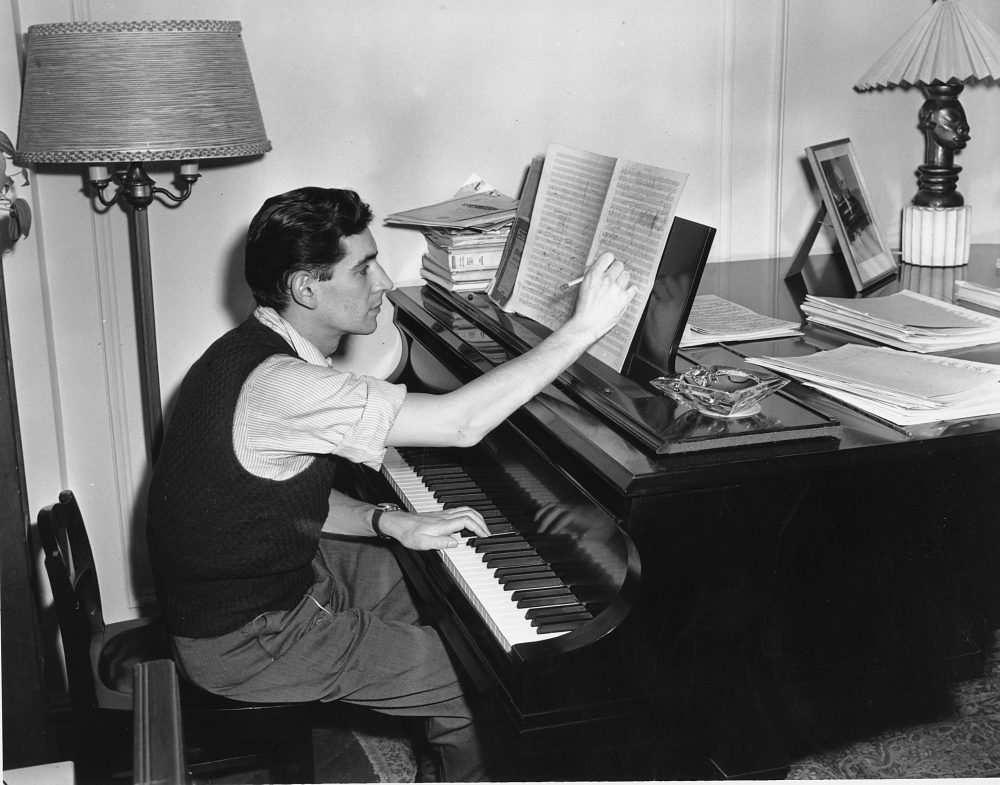 Composer, conductor and pianist Leonard Bernstein works on a score in his apartment. He's in his late 20s in this photograph. (AP)