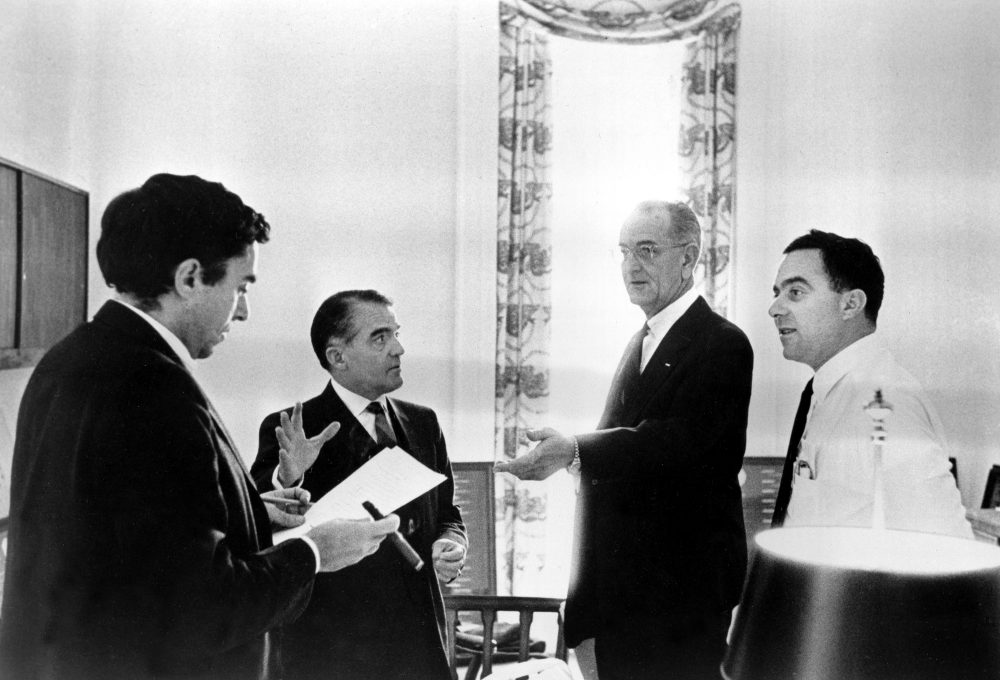 U.S. President Lyndon B. Johnson consults with assistants while drafting the State of the Union address at the White House in Washington, D.C., Jan. 12, 1966.  From left are, Richard Goodwin, former presidential assistant called back from Wesleyan University to help on the speech; Jack Valenti; President Johnson; and Joseph A. Califano, Jr.  (AP Photo/The White House)