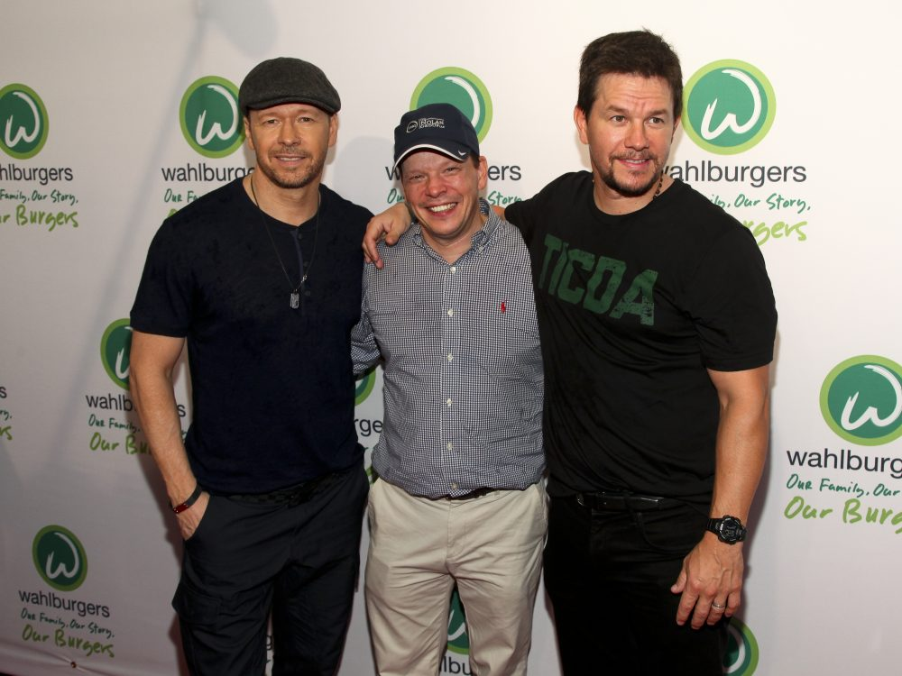 From left: Donnie, Paul and Mark Wahlberg attend the Wahlburgers Coney Island preview party on June 23, 2015, in New York. (Andy Kropa/Invision/AP)