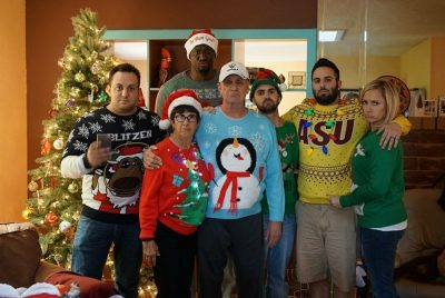 Blondy, the Blitzes, et al. look unhappy, despite their stunning collection of bad Christmas sweaters. (Courtesy Blondy Baruti)
