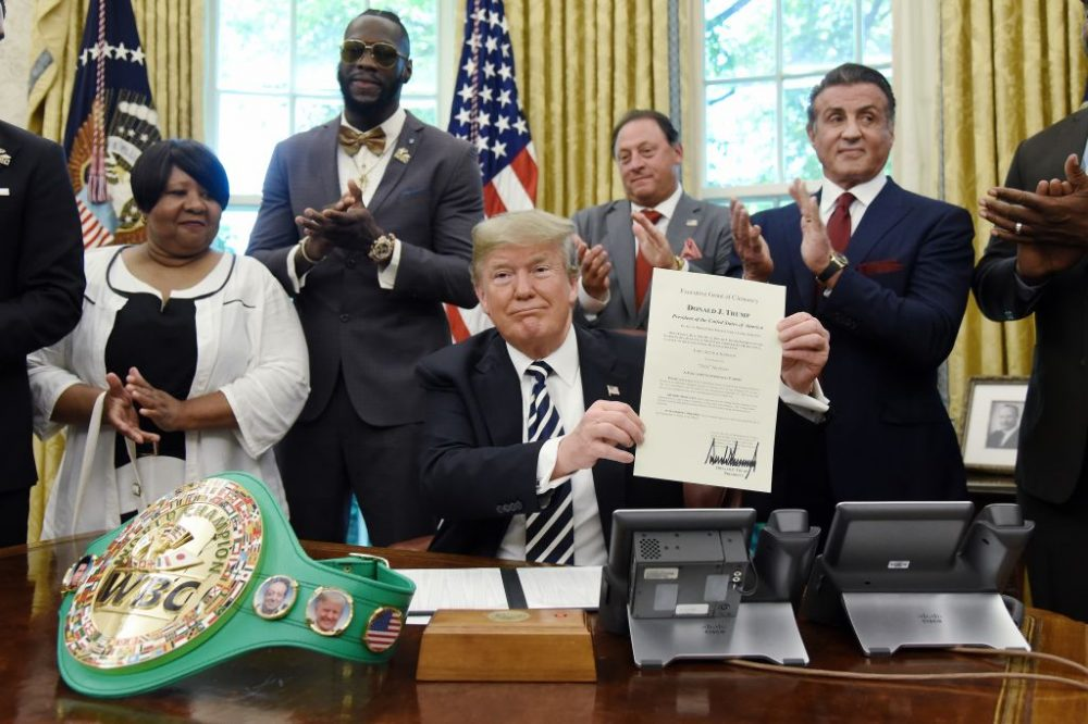 President Donald Trump holds a signed Executive Grant of Clemency for boxer Jack Johnson, May 24, 2018. (Left to right) Linda Haywood, great great niece of Jack Johnson, Deontay Wilder, Keith Frankel, Sylvester Stallone and boxer Lennox Lewis. (Olivier Douliery-Pool/Getty Images)