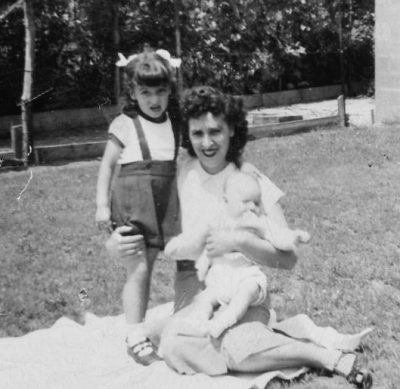 Marianne is pictured with her mother and her baby brother, Michael, in their back yard in the mid 1950s. (Courtesy of the author)