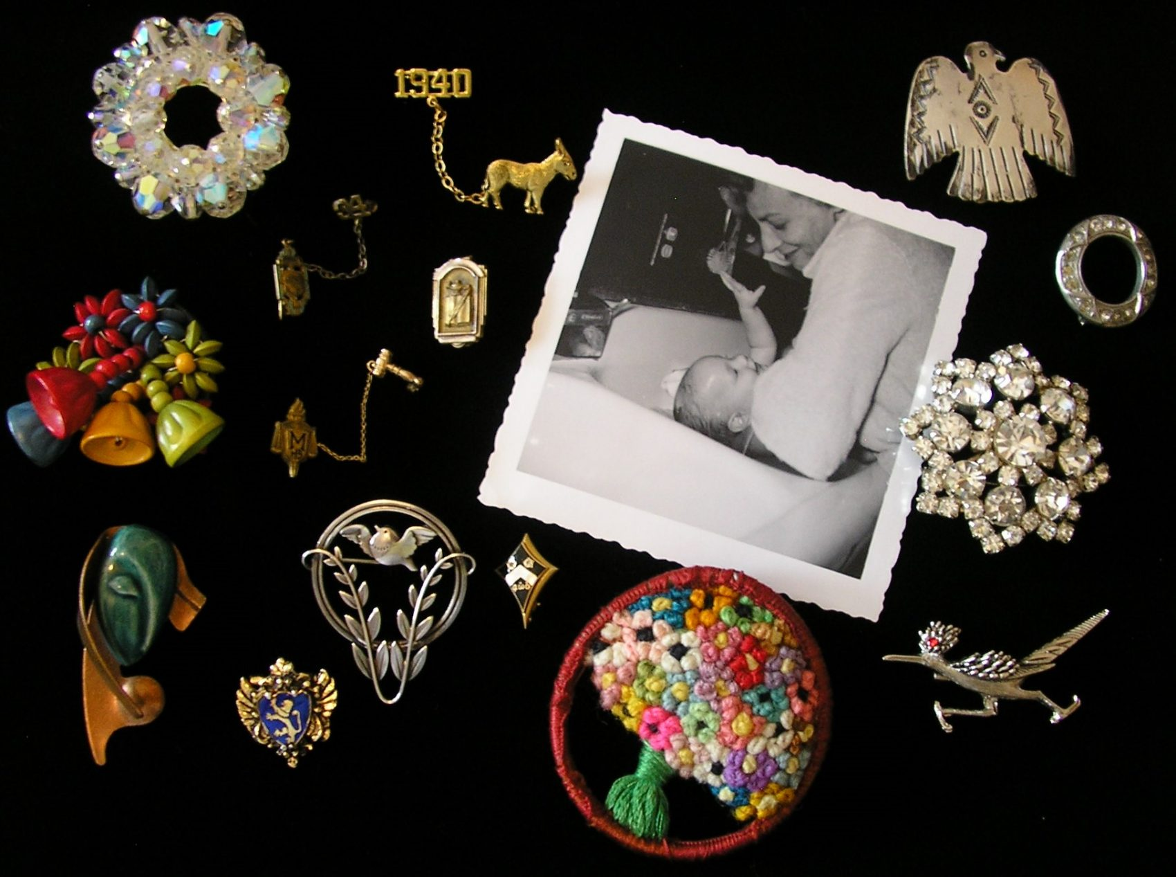 The pins that belonged to the author's mother, alongside a photo of the author and her mother, circa 1961. (Courtesy)