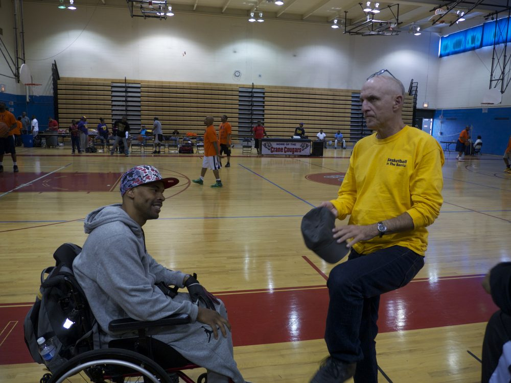 """Shawn Harrington and Rus Bradburd talk after Shawn's """"Hoops for Peace Chicago"""" games.  (Michael James)"""