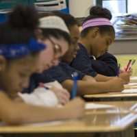 In this April 2017 photo, sixth grade students from the Boston Collegiate Charter School work on math problems during class. (Jesse Costa/WBUR)