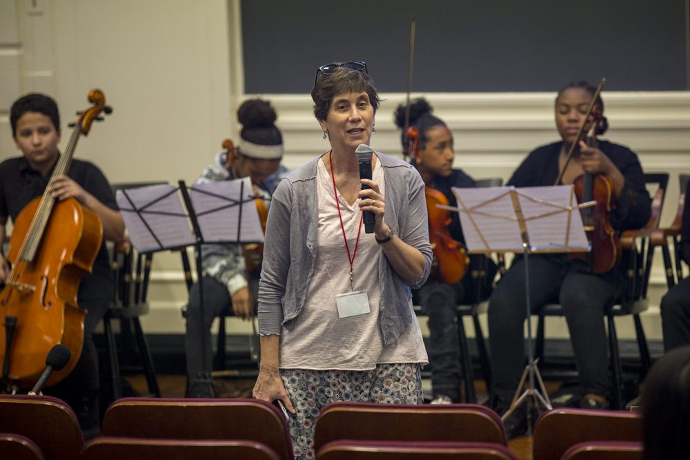 Linda Nathan introduces a group of students from the Conservatory Lab Charter School during a recent conference at the Harvard Graduate School of Education. (Jesse Costa/WBUR)