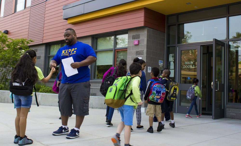 Keith Dixon greets students on their way in to KIPP Academy Boston at the beginning of the day. (Carrie Jung/WBUR)