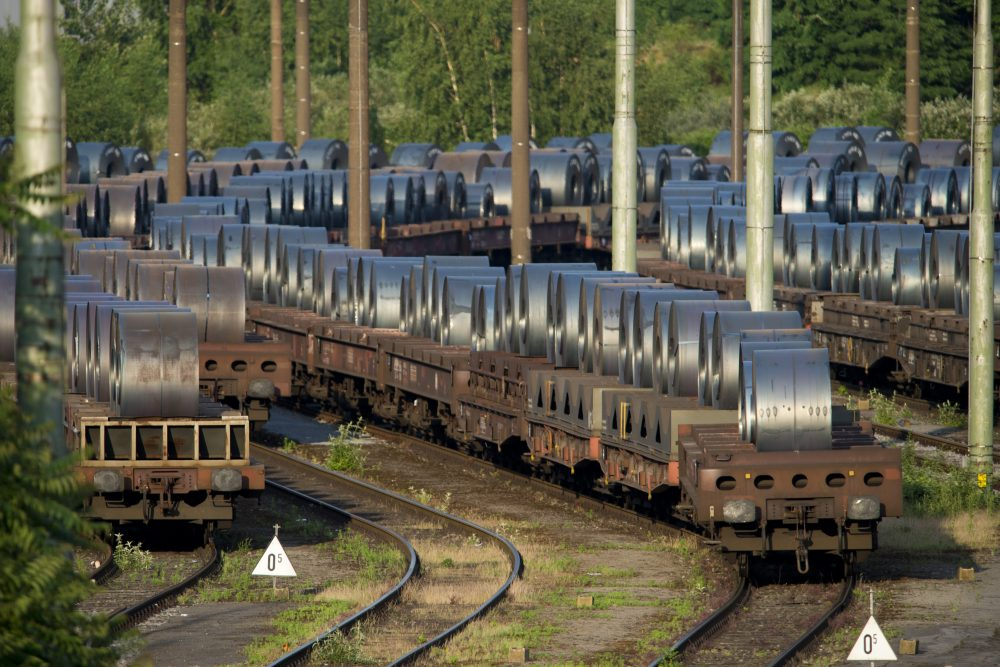 Rail cars loaded with rolled-up steel on the site of ThyssenKrupp Schwelgern steel plant on May 30, 2018 in Duisburg, Germany. (Michael Gottschalk/Getty Images)