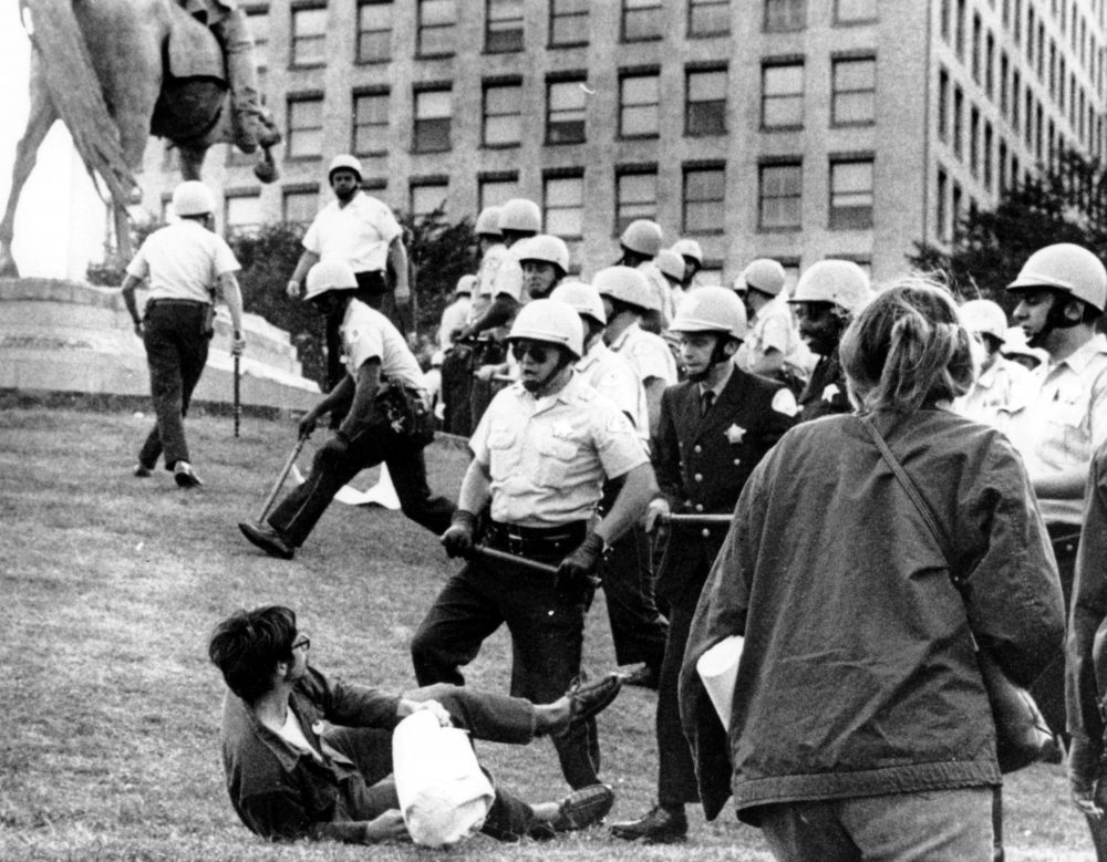 In this Aug. 26, 1968 file photo, Chicago police officers confront a demonstrator on the ground at Grant Park in Chicago during the city's hosting of the Democratic National Convention. (AP Photo)