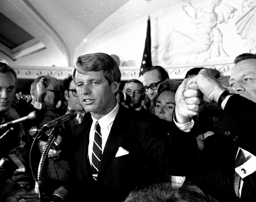 Sen. Robert F. Kennedy addresses a throng of supporters in the Ambassador Hotel in Los Angeles early in the morning of June 5, 1968, following his victory in the previous day's California primary election.  A moment later he turned into a hotel kitchen corridor and was critically wounded.  His wife, Ethel, is just behind him. (Dick Strobel/AP)