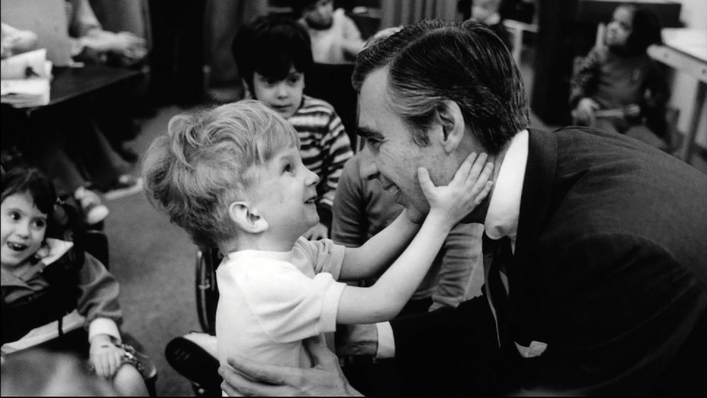 "Fred Rogers, pictured here with a young fan, is the subject of the new documentary, ""Won't You Be My Neighbor?' (Courtesy Focus Features)"
