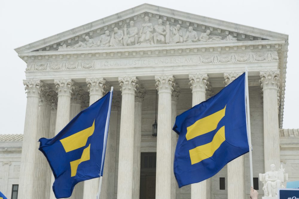 Supporters of LGBTQ equality fly Human Rights Campaign flags in front of the Supreme Court during oral arguments for Masterpiece Cakeshop case on Tuesday, Dec. 5, 2017, in Washington. (Kevin Wolf/AP Images for Human Rights Campaign)