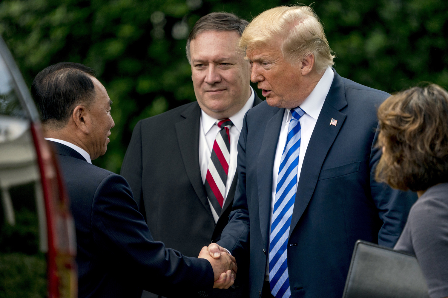 President Donald Trump shakes hands with Kim Yong Chol, former North Korean military intelligence chief and one of leader Kim Jong Un's closest aides, as Secretary of State Mike Pompeo watches upon departure after their meeting in the Oval Office of the White House in Washington, Friday, June 1, 2018. (Andrew Harnik/AP)