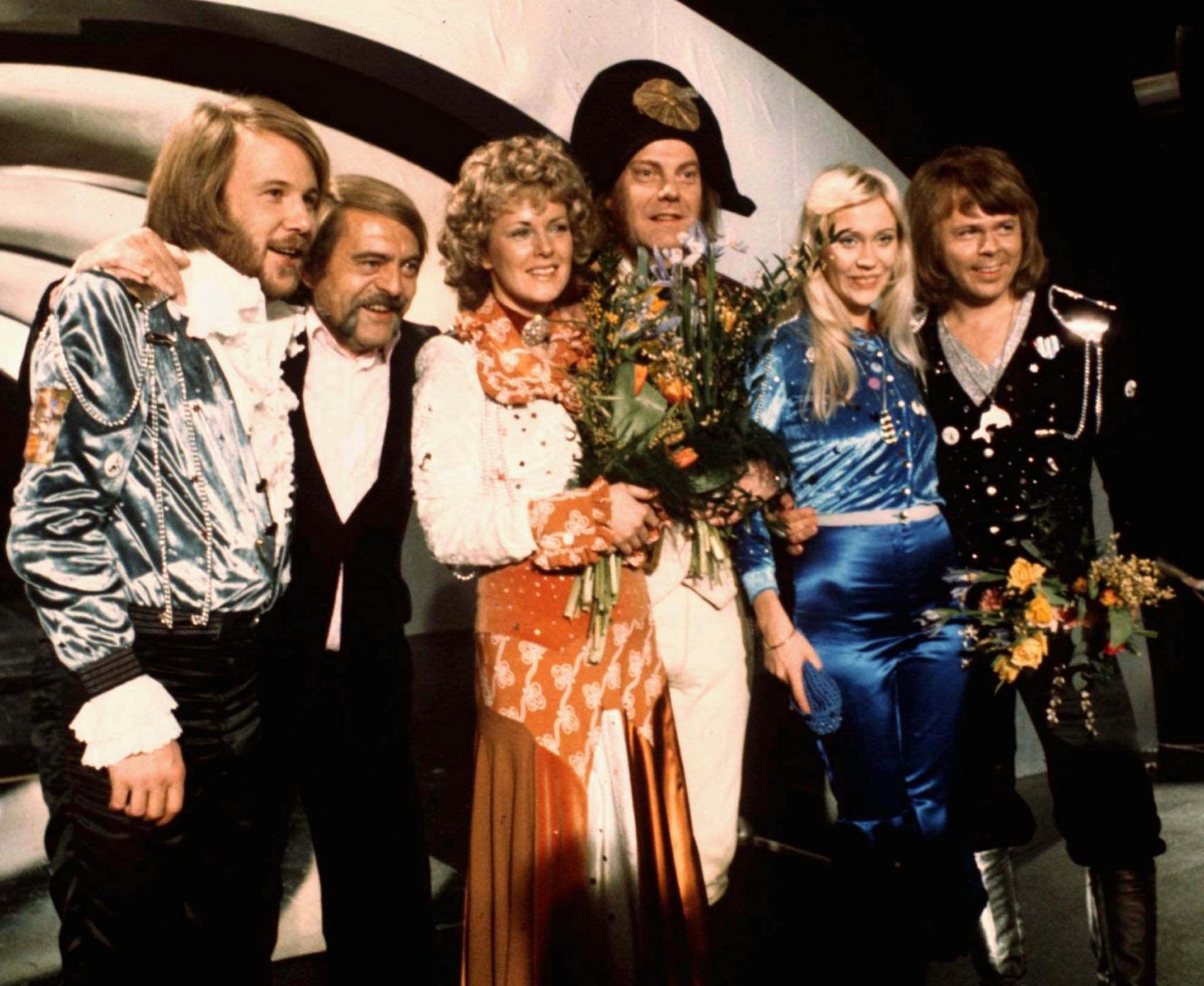 "In this April 6, 1974 photo, members of Swedish group ABBA and associates celebrate the victory of their song ""Waterloo"" in the Eurovision Song Contest. (AP)"