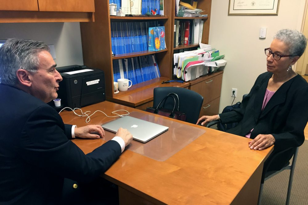 In this Thursday, May 24, 2018 photo, Adine Usher, 78, meets with breast cancer study leader Dr. Joseph Sparano at the Montefiore and Albert Einstein College of Medicine in the Bronx borough of New York. Usher was one of about 10,000 participants in the study which shows women at low or intermediate risk for breast cancer recurrence may safely skip chemotherapy without hurting their chances of survival. (Kathy Young/AP)