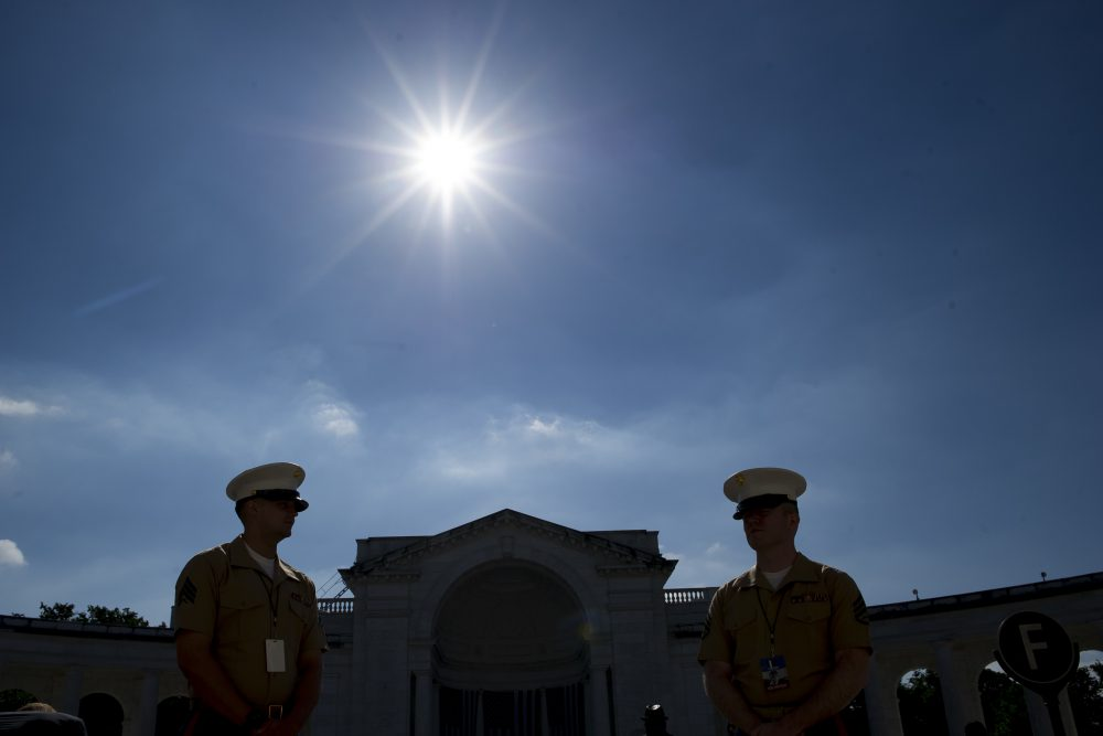 Marine Corps Sgts. wait to direct attendees to their seats at the Celebration of the Life of Robert F. Kennedy at Arlington National Cemetery in Arlington, Va., where the Navy veteran is buried. (Cliff Owen/AP)