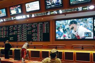 In this Monday, May 14, 2018 file photo, people make bets in the sports book area of the South Point Hotel and Casino in Las Vegas. (John Locher/AP)