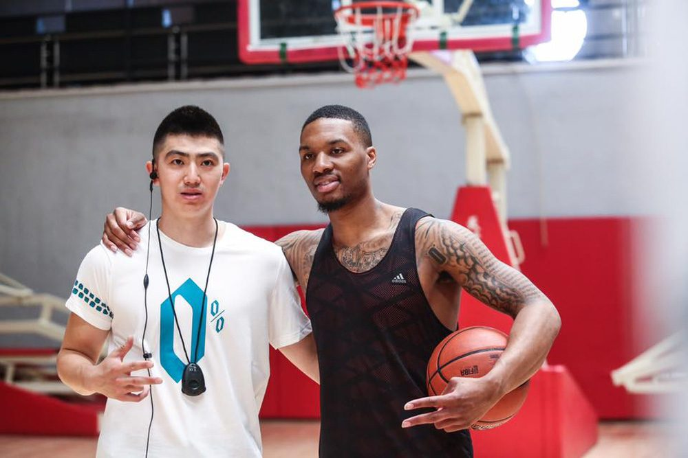 Saiyuan Bian fell in love with basketball as a kid growing up in China. He thought the game could take him to the moon. It hasn't taken him quite that far, but it has taken him around the world -- and brought him closer to NBA players like Damian Lillard. (Courtesy Saiyuan Bian)