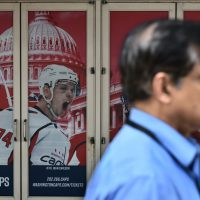 A pedestrian passes by a poster outside of the Capital One Arena on June 5, 2018 in Washington, D.C., as the Washington Capitals head into game 5 of the Stanley Cup against the Vegas Golden Knights. (Mandel Ngan/AFP/Getty Images)