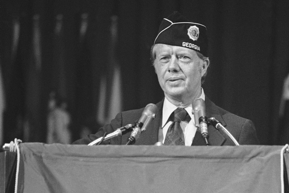 Presidential candidate Jimmy Carter speaks to members of the American Legion at their national convention in Seattle on Aug. 24, 1976. Carter called for a blanket pardon for Vietnam draft resisters, and later pardoned them as president in 1977. (AP Photo)