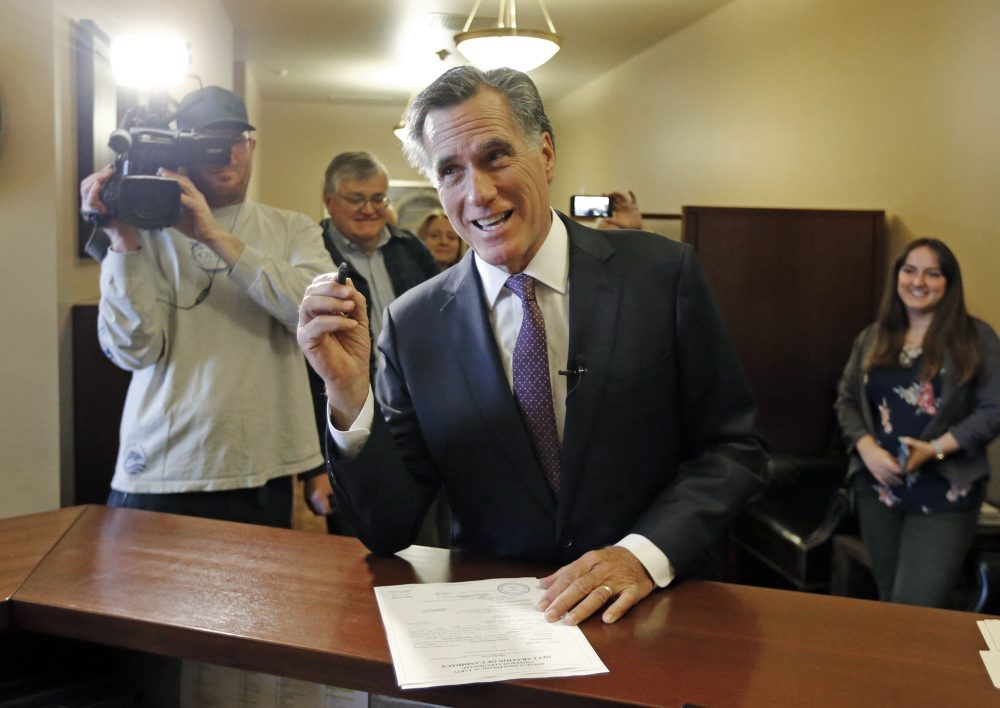 Mitt Romney smiles as he declares his candidacy for the U.S. Senate at the state elections office, at the Utah State Capitol, in Salt Lake City on March 15. (Rick Bowmer/AP)