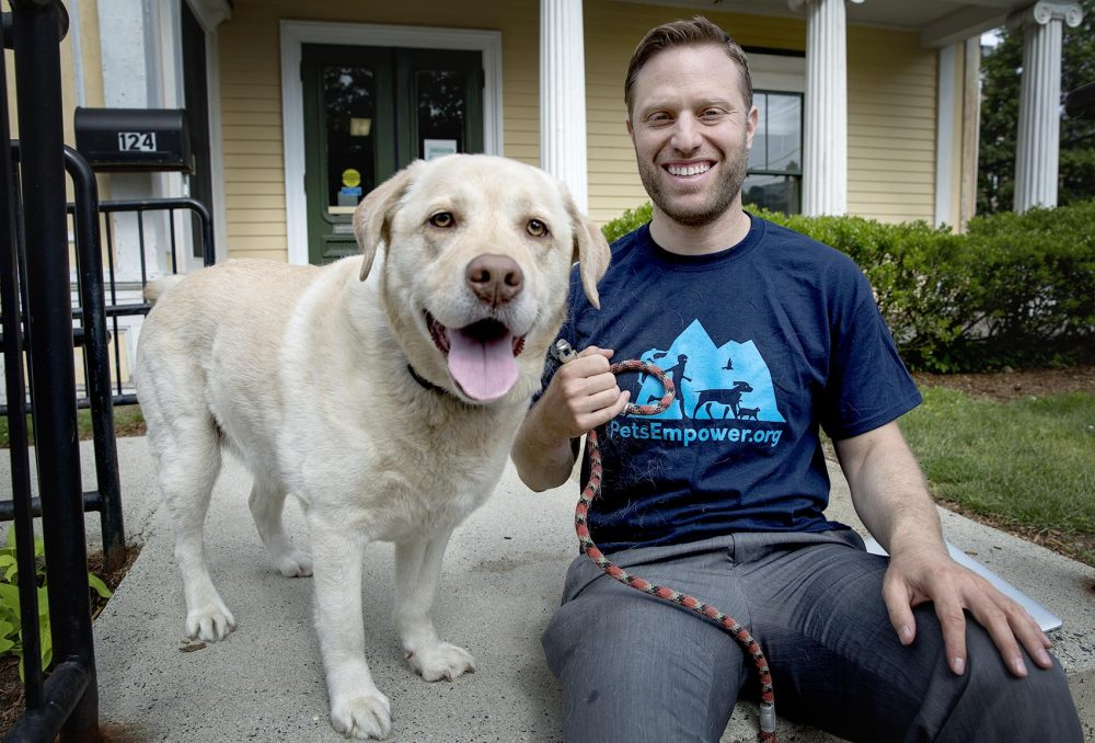 PetsEmpower's founder and executive director, Jordan Ross, with his dog Kariya. (Robin Lubbock/WBUR)