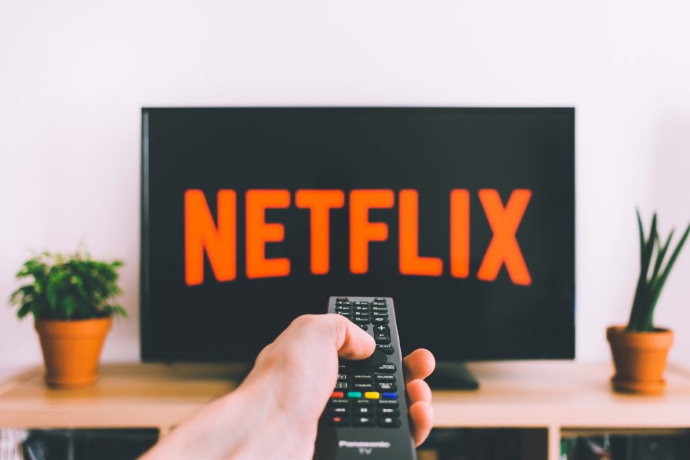 The Netflix logo displayed on a screen. (freestocks/Unsplash)