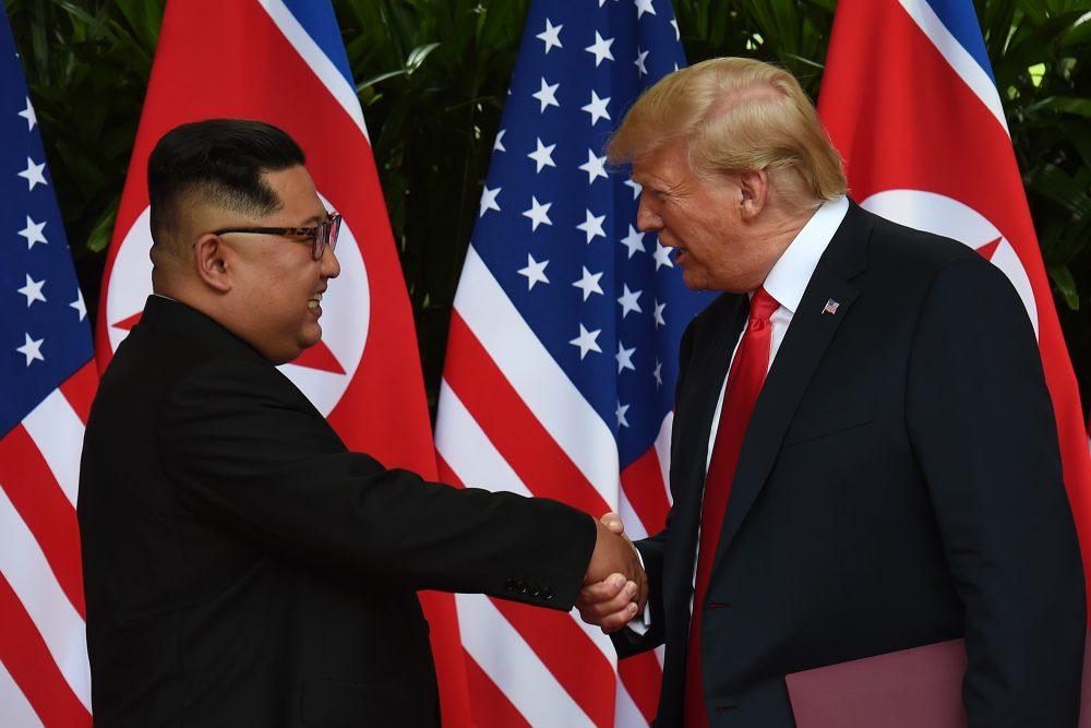 North Korea's leader Kim Jong Un shakes hands with President Trump after taking part in a signing ceremony at the end of their historic summit at the Capella Hotel on Sentosa island in Singapore on June 12, 2018. (Anthony Wallace/AFP/Getty Images)