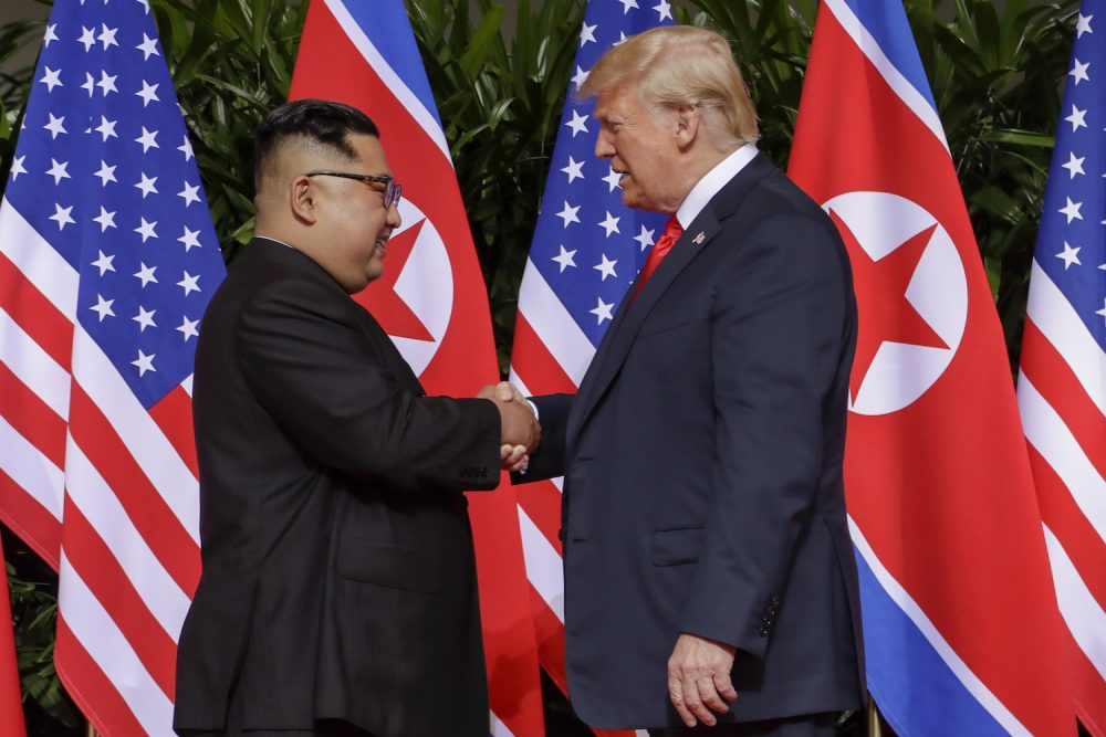 U.S. President Donald Trump shakes hands with North Korea leader Kim Jong Un at the Capella resort on Sentosa Island Tuesday, June 12, 2018 in Singapore. (Evan Vucci/AP)