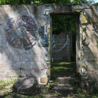 The Ruins Project invites mosaicists from all over the world to adorn the walls of a Western Pennsylvania coal mine facility, the entrance pictured here. (Adelina Lancianese/WESA)